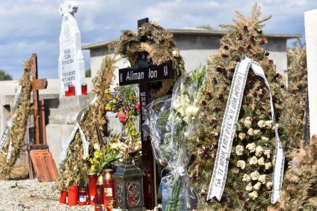 Funeral wreaths near the grave of late mayor Ion Aliman, in Deveselu