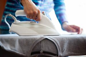 Woman's hands ironing